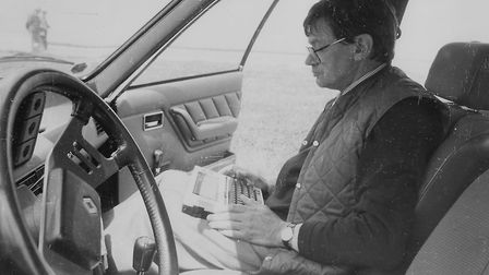Robin Williams using his Tandy laptop computer in Normandy. He created quite a stir among fellow jou