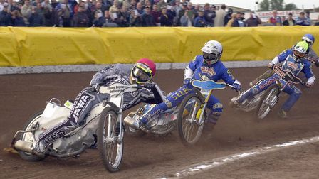 King's Lynn Knights' captain. Jason Crump, leads out of the first bend, chased by Tony Rickardsson