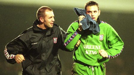 Richard Wright leaves the field to have stitches in a facial injury against Oxford in 1998. Picture: