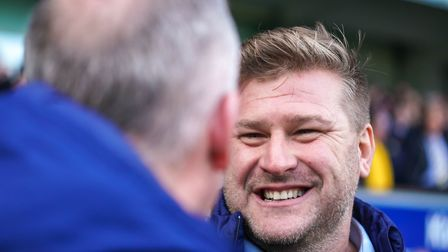 Oxford United manager Karl Robinson shakes hands with Town manager Paul Lambert ahead of the game.