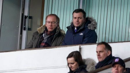With Town a goal down owner Marcus Evans can't look, as he sits with Town general manager of footbal