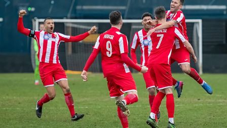 The Seasiders celebrate a 90th minute goal as Stuart Ainsley jumps into the arms of goalscorer Miles