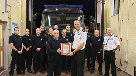 Derek Oxborough receiving a certificate to mark his long service from chief fire officer Mark Hardin