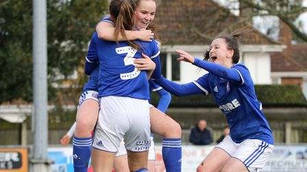 Amy-Leigh Abrehart celebrates with Eva Hubbard and Eloise King as Town Women beat Stevenage 7-0 for
