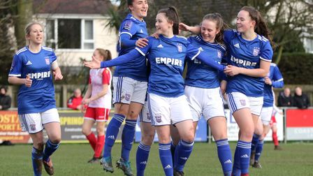 Eloise King celebrates with Sophie Peskett, Eva Hubbard and Amy-Leigh Abrehart as Town Women beat S