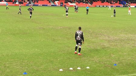 The teams are just about to kick off at Salford City, but someone has forgotten to remove the cones