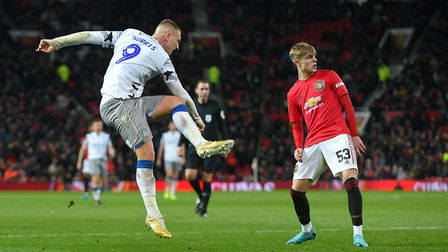 Luke Norris, who has netted nine goals so far this season, fires in a shot at Old Trafford against M