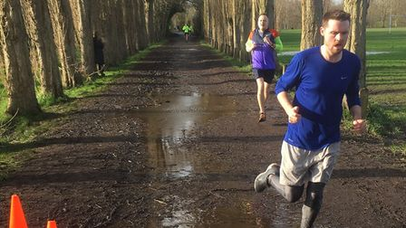 Runners in the tree-lined avenue at the finish to the Fletcher Moss parkrun last Saturday morning. P