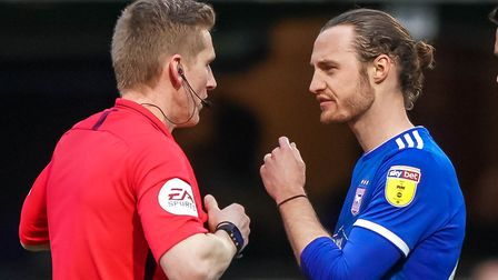 Will Keane speaks with referee Scott Oldham after he had dismissed Kayden Jackson. Picture Steve Wa