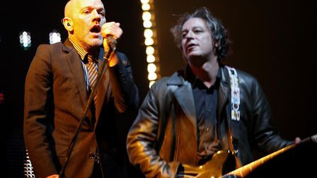 Peter Buck, right, performing with Michael Stipe and REM at Twickenham stadium in London. Picture: M