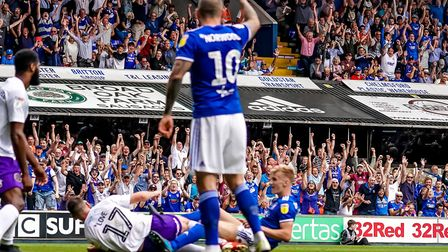 Fans in the stands celebrate Flynn Downes third goal in Ipswich Town's 3-0 victory over Shrewsbury T