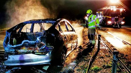 The scene after the car fire on the A11 between Elveden and Mildenhall. Picture: SUFFOLK FIRE AND RE