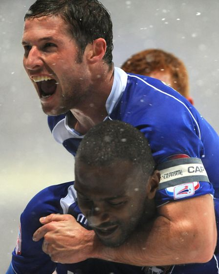Jason Scotland and David Norris celebrate during Ipswich Town's snow affected match against Leiceste