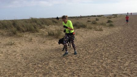 Runners and dogs toiled, but conquered, the windy conditions at the Great Yarmouth North Beach parkr