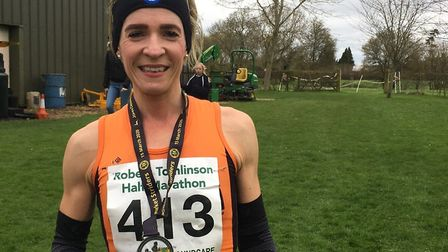 Helen Davies, pictured with her medal after finishing first lady and third overall at the Stowmarket