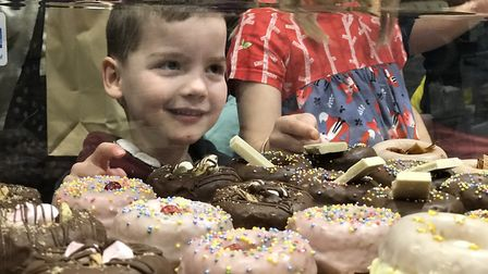 """""""I'll have that one please?"""" A youngster eyes up the yummy doughnuts at the Essex Vegan Festival in"""
