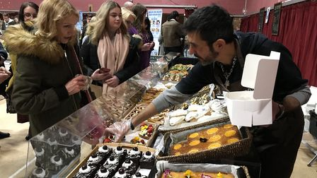 100% yummy. 100% vegan. A customer fills a box with cakes at the Essex Vegan festival in Colchester.