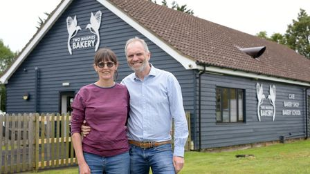 Co-owners Rebecca Bishop and Steve Magnall outside Two Magpies bakery in Darsham Picture: SARAH LU