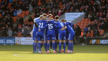The Ipswich team huddle before kick-off at Blackpool. Picture Pagepix Ltd