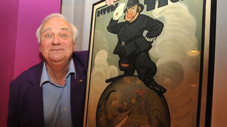 Roy Hudd, who died this week at age 83, pictured with a poster from his music hall collection Photo