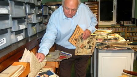 Roy Hudd pictured working inside his large music hall archive which collected together posters, prog