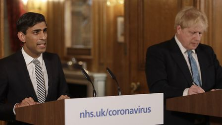 Chancellor Rishi Sunak with Prime Minister Boris Johnson at the press conference before the Commons