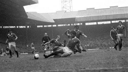 Manchester United's Martin Buchan slides in to clear the ball as Ipswich Town's Frans Thijssen chall