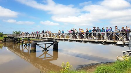Walkers on the bridge at Southwold
