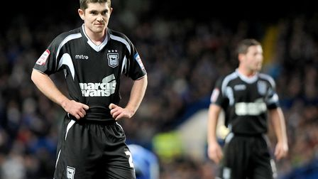 Young striker Ronan Murray is grim-faced as Ipswich are thrashed 7-0 by Chelsea at Stamford Bridge.