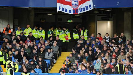 Subdued: Ipswich Town fans at Stamford Bridge didn't have much to shout about, during a 7-0 rout. Pi