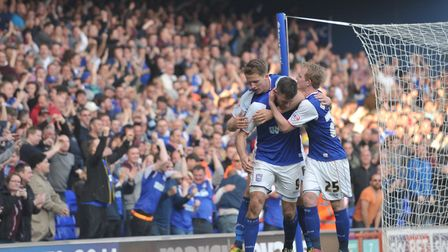 Daryl Murphy celebrates his goal with Christophe Berra and Jonny Williams, during the 1-1 draw again
