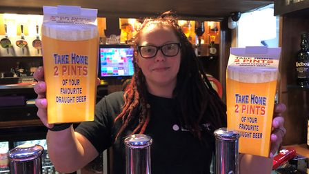 Maz Pearson of the Gladstone Arms in Combs Ford, Stowmarket, with the take-out beer cartons for cust