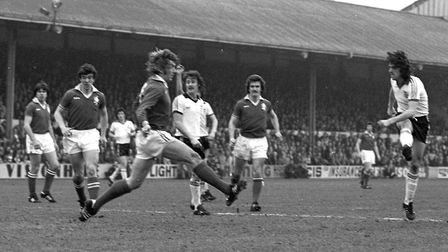 John Wark, right, scores for Town in their 6-1 win at Millwall in the FA Cup quarter-final. Picture: