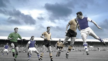 Ipswich's Roy 'Rocky' Stephenson challenges for the ball at Portman Road in September 1962 during a