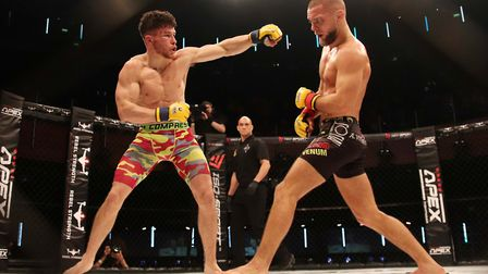 Steve Aimable, left, dropped a points decision to featherweight champion in a non-title fight Mads B