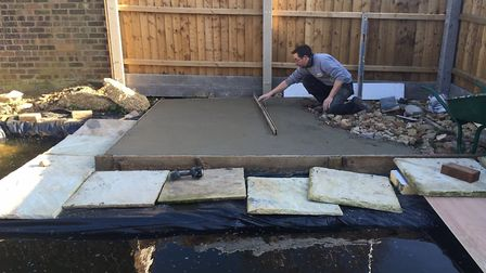 Mr Jarvis laying the concrete for the summer house Picture: Charlotte Smith-Jarvis