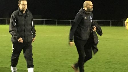 Bury Town boss Ben Chenery, right,, and Walsham-le-Willows new manager Trevor Collins walk towards t