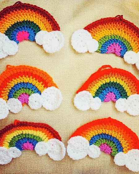 Kate Clifford has crocheted rainbows to hang outside her house in Bures High Street to cheer up pass