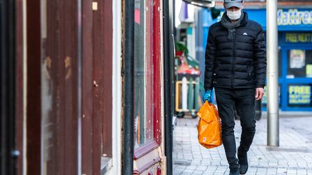 A man in Ipswich wears a face mask to ward off coronavirus - how might life be different once the pa