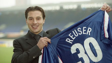 Martijn Reuser holding his Ipswich Town shirt after signing on loan in March 2000