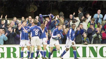 Martijn Reuser is congratulated after scoring on his debut against Fulham in March 2000. It was a la