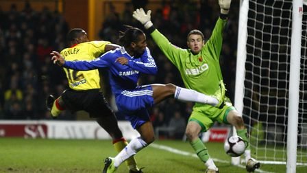 Scott Loach denies Chelsea's Didier Drogba during his time at Watford. Photo: PA