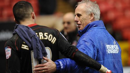 Mick McCarthy gives Stephen Henderson a hug. Photo: Pagepix