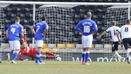 Scott Loach saves a penalty from Derby's Jamie Ward with his feet. Photo: Pagepix