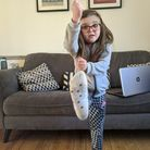 Rosie Ward, 5, doing PE with Joe Wicks at her home near Stowmarket Picture: SAM EMMENS