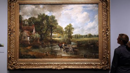 V&A museum employee Olivia Colling looks at John Constable's The Hay Wain at the opening of a new ex