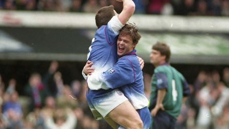 Neil Gregory celebrates with goalscorer Geriant Williams as Town beat Oldham 4-0 at Portman Road in