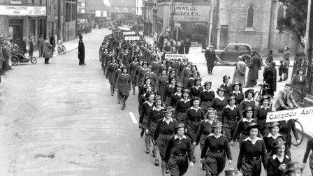 Womans Land Army members, from Suffolk towns and villages, marching along Crown Street, Ipswich, in