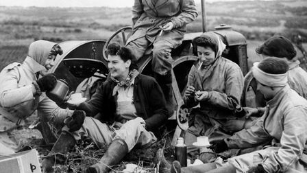 Land Girls enjoying tea-time in the fields of Essex Picture: PRESS ASSOCIATION