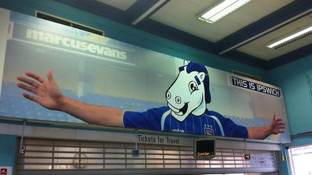 A drawing of town mascot Bluey has been cut and pasted over the Michael Chopra poster at Ipswich rai